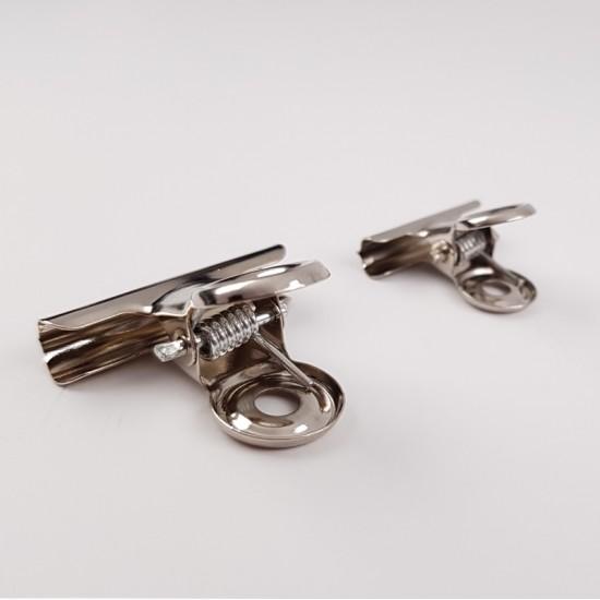 Metalinis segtukas / spaustukas nago arkos formavimui